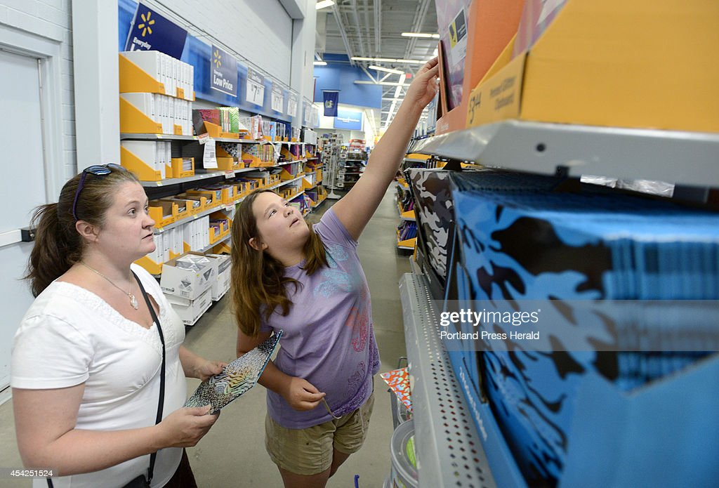 Rigina Lemire from Westbrook and her 10 year old daughter Saige were among parents and their children to shop for school supplies at Walmart in Scarborough.