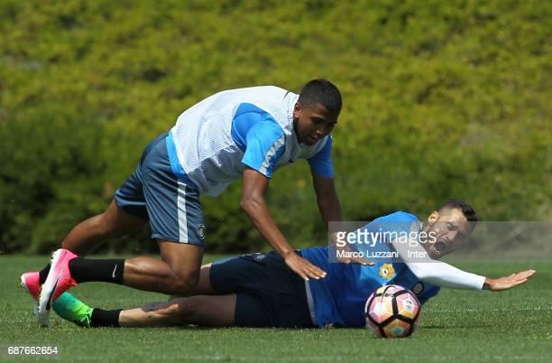 Rigo Berto Rivas clashes with Antonio Candreva during the FC Internazionale training session at the club's training ground Suning Training Center in...