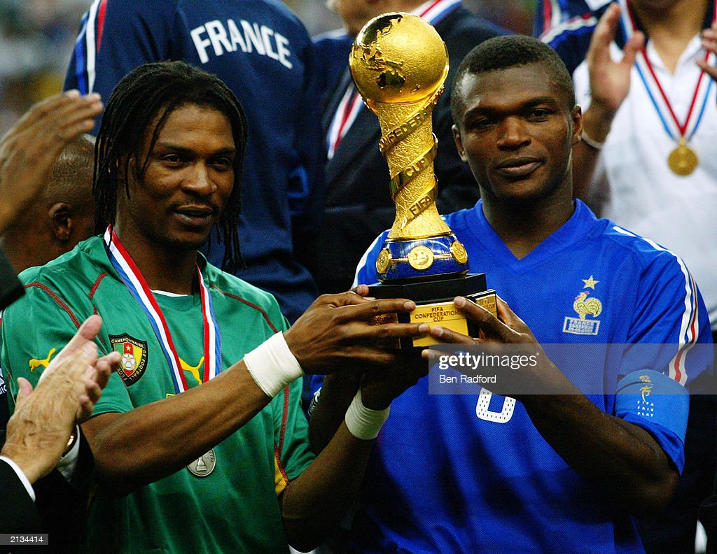 Rigobert Song of Cameroon and Marcel Desailly of France both hold
