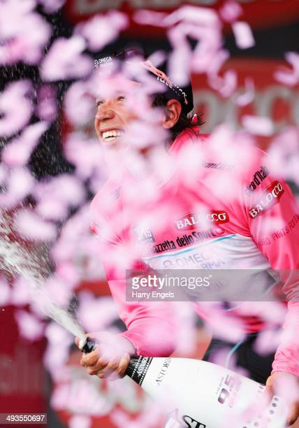 Rigoberto Uran of Colombia and team Omega PharmaQuickStep celebrates retaining the Maglia Rosa leader's jersey following the fourteenth stage of the...