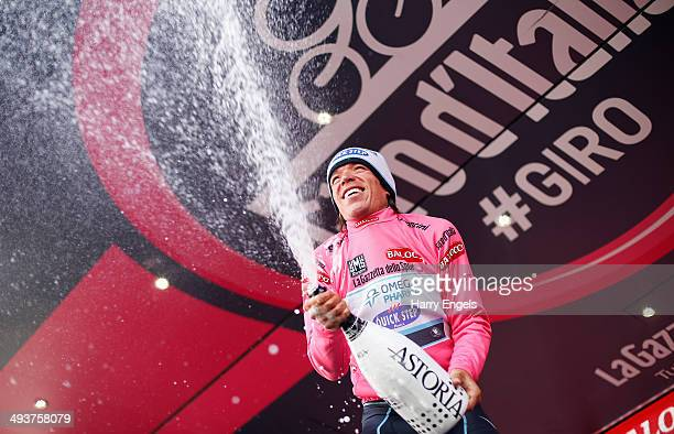 Rigoberto Uran of Colombia and team Omega PharmaQuickStep celebrates retaining the Maglia Rosa leader's jersey following the fifteenth stage of the...