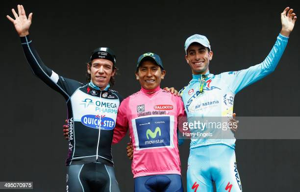 Rigoberto Uran of Colombia and team Omega PharmaQuickStep Nairo Quintana of Colombia and team Movistar and Fabio Aru of Italy and team Astana stand...