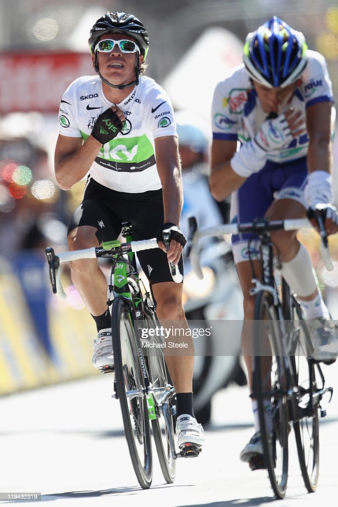 <a gi-track='captionPersonalityLinkClicked' href=/galleries/search?phrase=Rigoberto+Uran&family=editorial&specificpeople=4122792 ng-click='$event.stopPropagation()'>Rigoberto Uran</a> (L) of Colombia and Team SKY Procycling crosses the finishing line to retain the white jersey during Stage 17 of the 2011 Tour de France from Gap to Pinerolo on July 20, 2011 in Pinerolo, Italy.