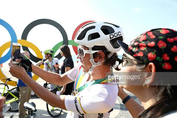 Rigoberto Uran Uran of Colombia takes selfie photographs before the Men's Road Race on Day 1 of the Rio 2016 Olympic Games at the Fort Copacabana on...