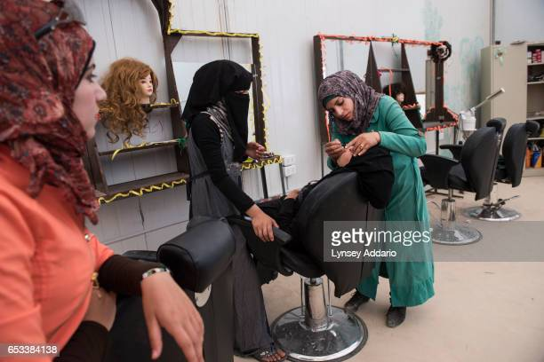 Rihab a Syrian refugee from Daraa teaches a class on beauty to other Syrian refugees in a program run by the Norweigan Refugee Council at Zaatari...