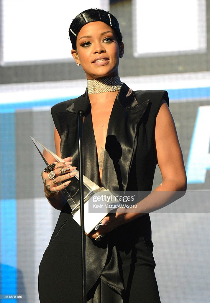 Rihanna accepts Icon Award onstage during the 2013 American Music Awards at Nokia Theatre L.A. Live on November 24, 2013 in Los Angeles, California.