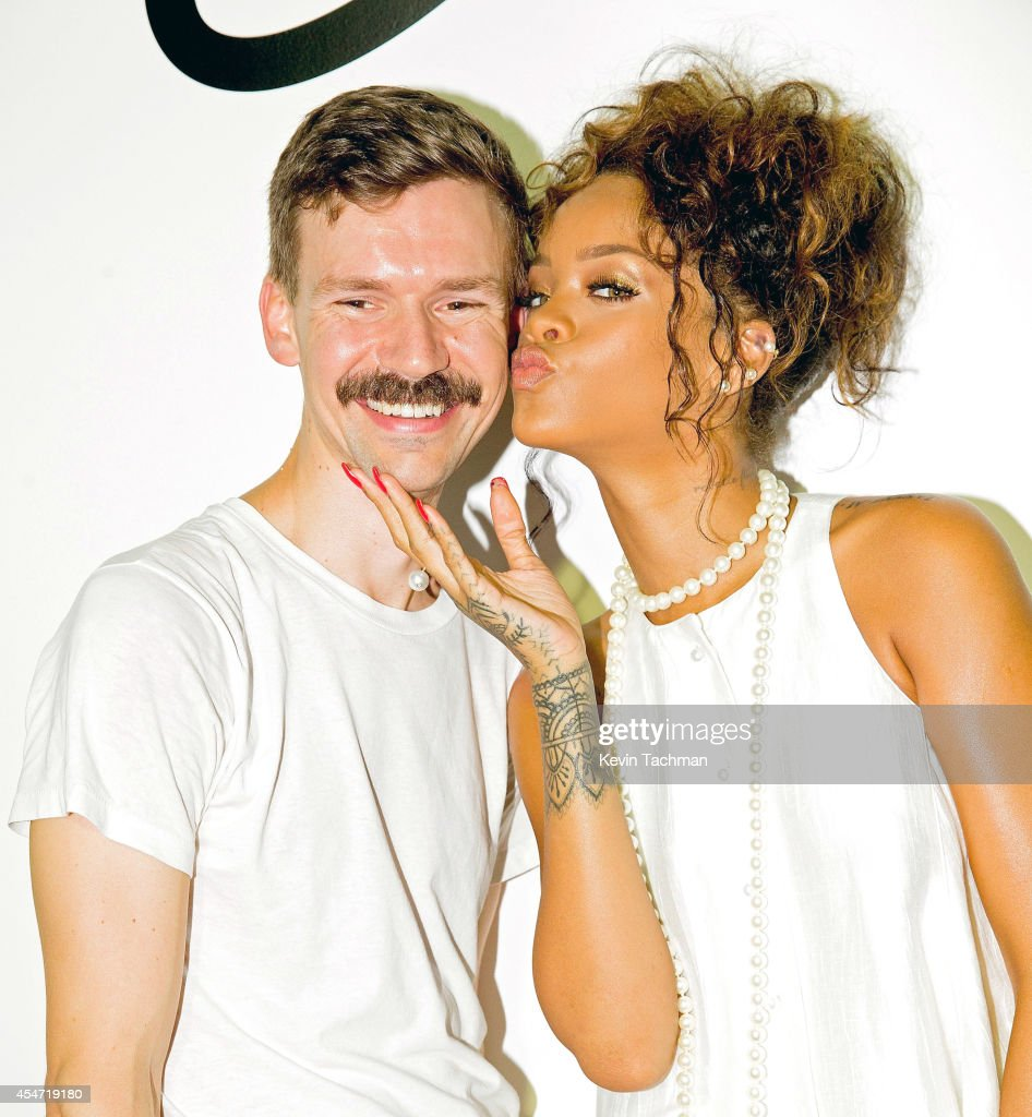 Rihanna and Adam Selman pose for a photo after Adam Selman's presentation during MercedesBenz Fashion Week Spring 2015 at Algus Greenspon Gallery on...