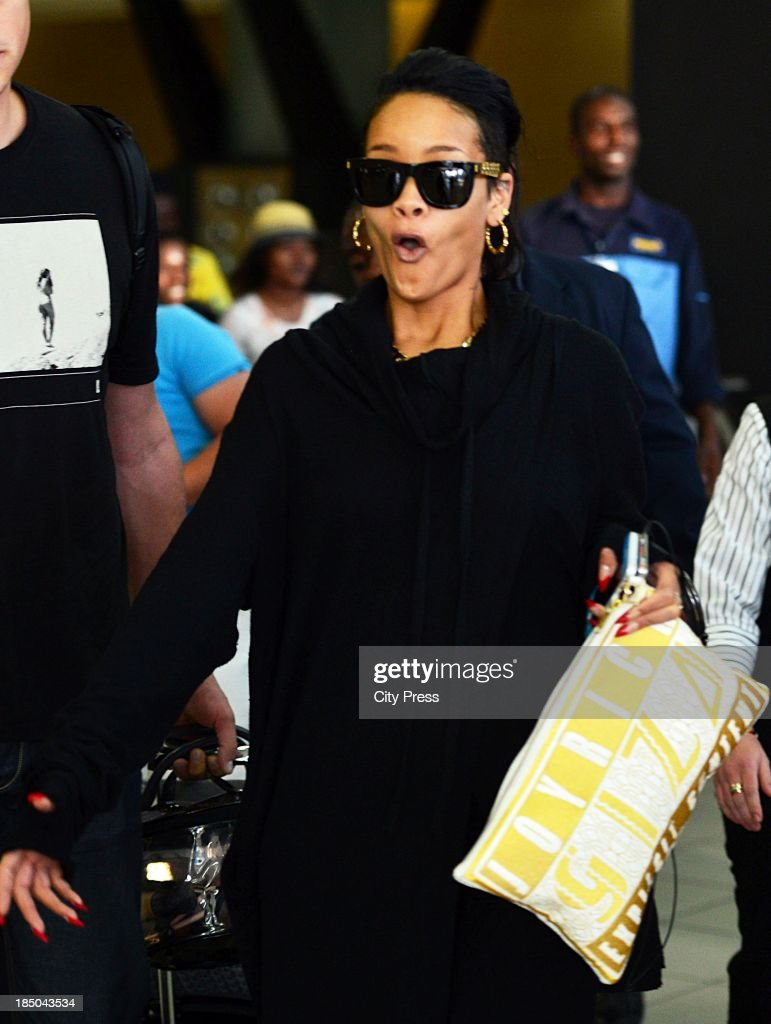 <a gi-track='captionPersonalityLinkClicked' href=/galleries/search?phrase=Rihanna&family=editorial&specificpeople=453439 ng-click='$event.stopPropagation()'>Rihanna</a> and arrives at OR Tambo International Airport on October 12, 2013, in Johannesburg, South Africa. The musician performed at the FNB Stadium on October 13, 2013, and will perform in Cape Town on October 16, 2013.