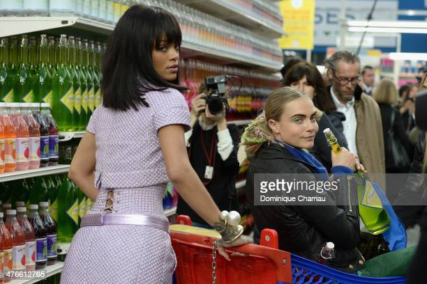 Rihanna and Cara Delevigne attend the Chanel show as part of the Paris Fashion Week Womenswear Fall/Winter 20142015 on March 4 2014 in Paris France