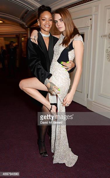 Rihanna and Cara Delevingne attend the British Fashion Awards at the London Coliseum on December 1 2014 in London England