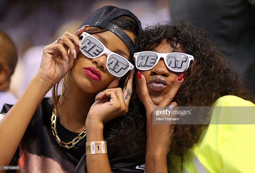 Rihanna and Melissa Forde attend Game 1 of the Eastern Conference Quarterfinals of the 2013 NBA Playoffs between the Miami Heat and the Milwaukee Bucks at American Airlines Arena on April 21, 2013 in Miami, Florida.
