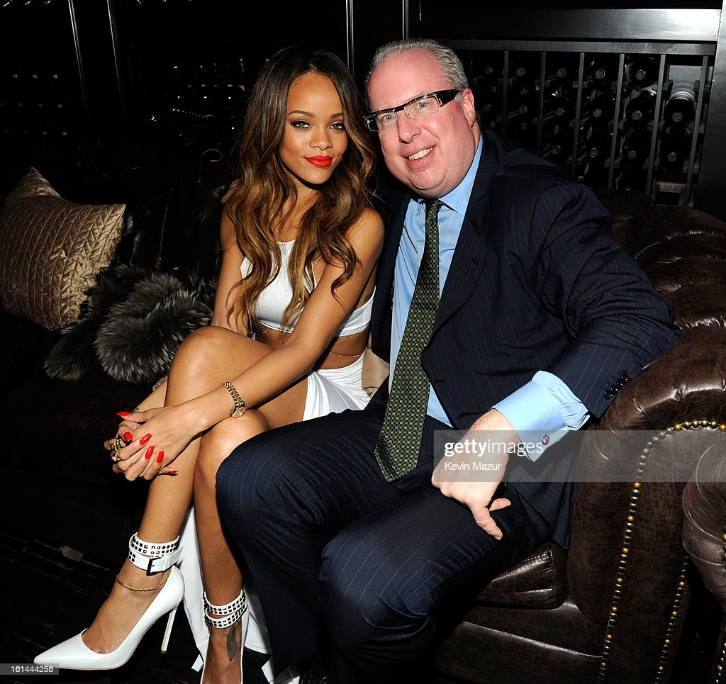 <a gi-track='captionPersonalityLinkClicked' href=/galleries/search?phrase=Rihanna&family=editorial&specificpeople=453439 ng-click='$event.stopPropagation()'>Rihanna</a> and President/COO of Island Def Jam Music Group, Steve Bartels attend the Island Def Jam Grammy Party Sponsored By Samsung And Pepsi at Osteria Mozza on February 10, 2013 in Los Angeles, California.