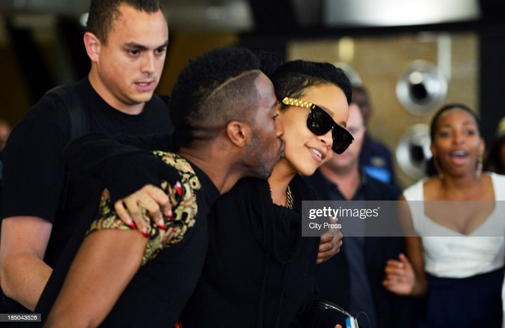 <a gi-track='captionPersonalityLinkClicked' href=/galleries/search?phrase=Rihanna&family=editorial&specificpeople=453439 ng-click='$event.stopPropagation()'>Rihanna</a> and Tazz Msika at OR Tambo International Airport on October 12, 2013, in Johannesburg, South Africa. The musician performed at the FNB Stadium on October 13, 2013, and will perform in Cape Town on October 16, 2013.