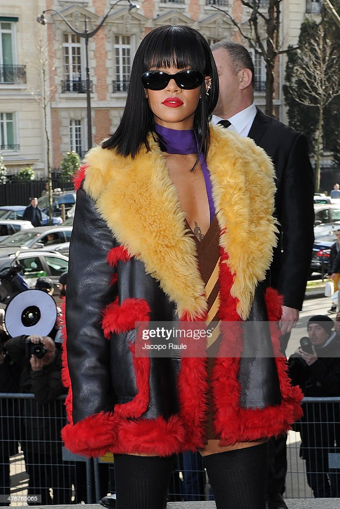 <a gi-track='captionPersonalityLinkClicked' href=/galleries/search?phrase=Rihanna&family=editorial&specificpeople=453439 ng-click='$event.stopPropagation()'>Rihanna</a> arrives at the Miu Miu show as part of the Paris Fashion Week Womenswear Fall/Winter 2014-2015 on March 5, 2014 in Paris, France.