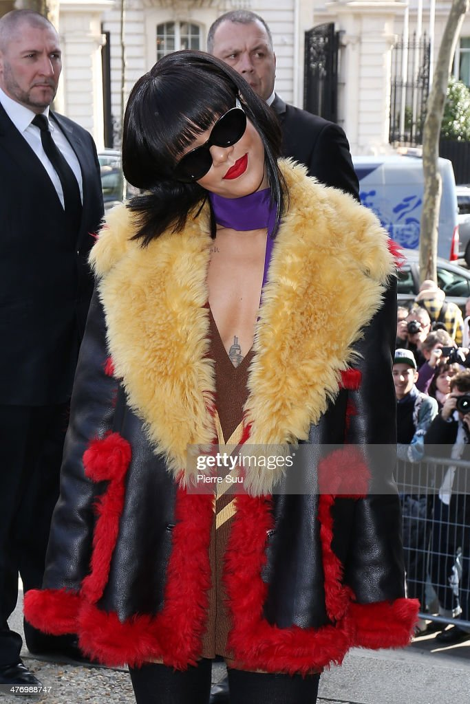 <a gi-track='captionPersonalityLinkClicked' href=/galleries/search?phrase=Rihanna&family=editorial&specificpeople=453439 ng-click='$event.stopPropagation()'>Rihanna</a> arrives at the Miu Miu show as part of the Paris Fashion Week Womenswear Fall/Winter 2014-2015 on March 5, 2014 on March 5, 2014 in Paris, France.