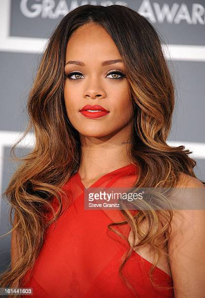 Rihanna arrives at the The 55th Annual GRAMMY Awards on February 10 2013 in Los Angeles California