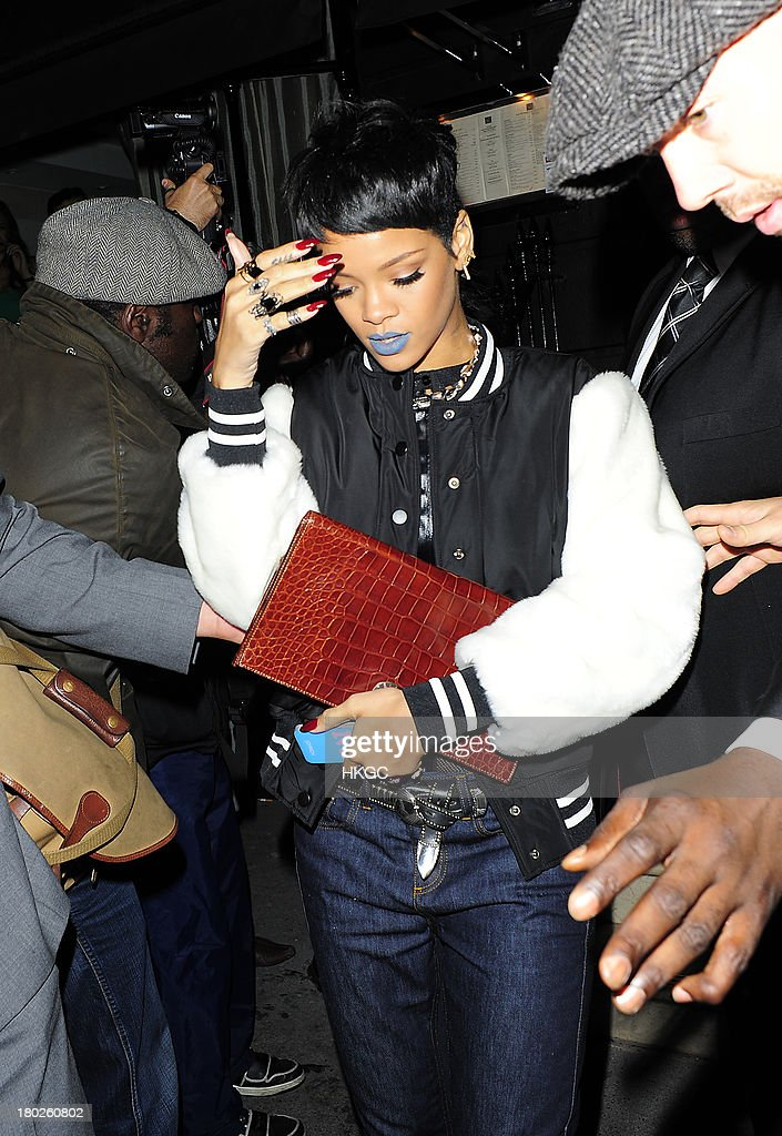 <a gi-track='captionPersonalityLinkClicked' href=/galleries/search?phrase=Rihanna&family=editorial&specificpeople=453439 ng-click='$event.stopPropagation()'>Rihanna</a> arrives for dinner with Cara Delevingne at Nozomi restaurant in Knightsbridge. on September 10, 2013 in London, England.