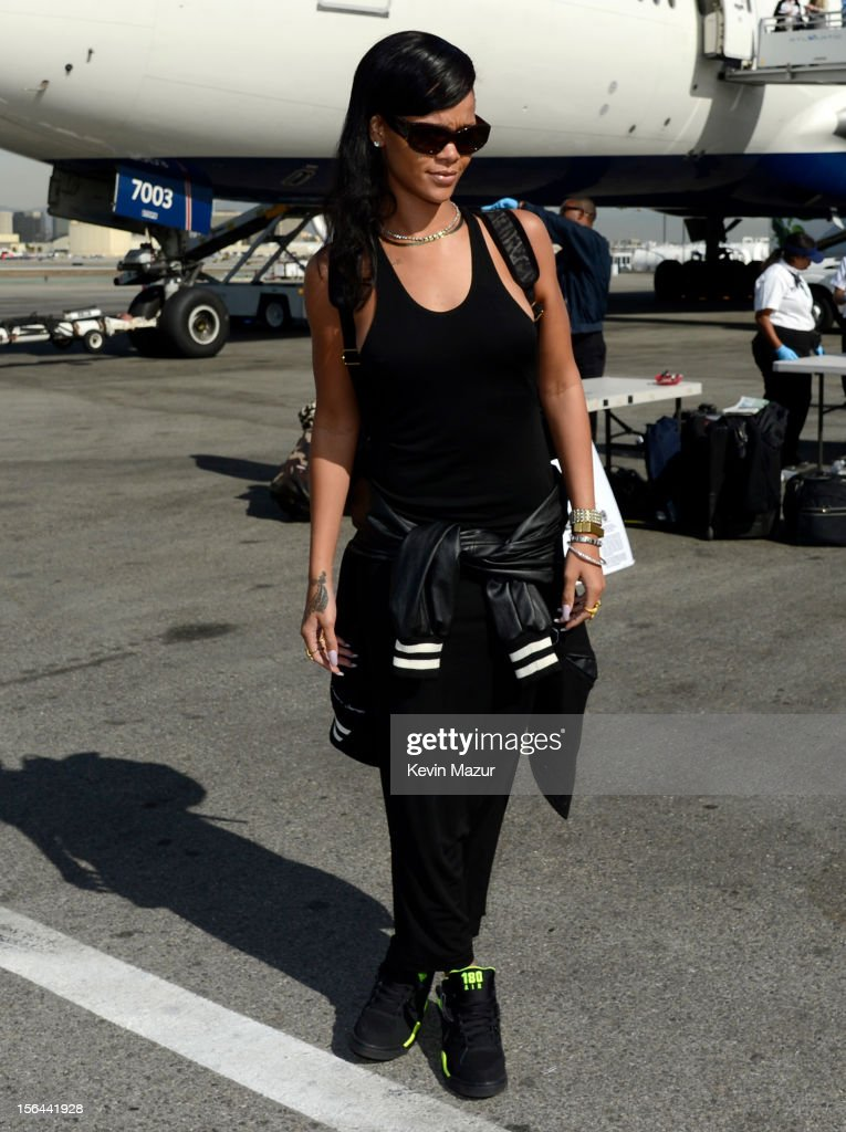 <a gi-track='captionPersonalityLinkClicked' href=/galleries/search?phrase=Rihanna&family=editorial&specificpeople=453439 ng-click='$event.stopPropagation()'>Rihanna</a> arrives on the plane to her first stop on the 777 tour on November 14, 2012. <a gi-track='captionPersonalityLinkClicked' href=/galleries/search?phrase=Rihanna&family=editorial&specificpeople=453439 ng-click='$event.stopPropagation()'>Rihanna</a>'s 777 Tour - 7 countries, 7 days, 7 shows in celebration of the November 19, 2012 release of 'Unapologetic.'