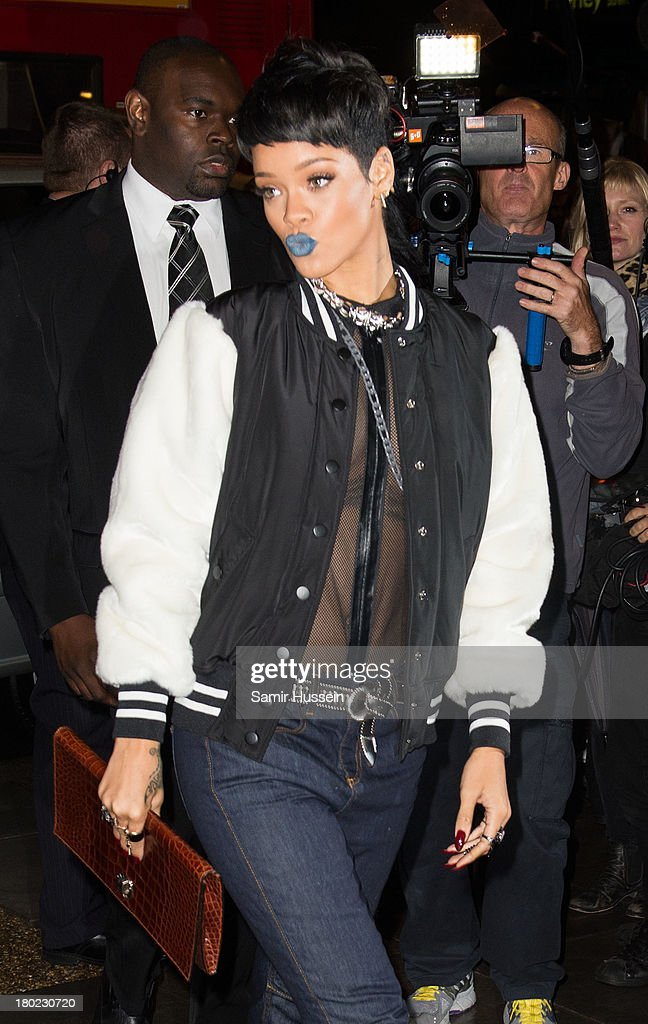<a gi-track='captionPersonalityLinkClicked' href=/galleries/search?phrase=Rihanna&family=editorial&specificpeople=453439 ng-click='$event.stopPropagation()'>Rihanna</a> attends a photocall to launch <a gi-track='captionPersonalityLinkClicked' href=/galleries/search?phrase=Rihanna&family=editorial&specificpeople=453439 ng-click='$event.stopPropagation()'>Rihanna</a> for River Island SS14 collection on September 10, 2013 in London, England.