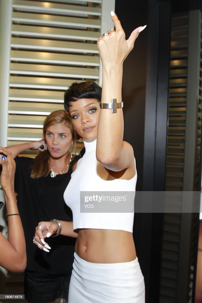 <a gi-track='captionPersonalityLinkClicked' href=/galleries/search?phrase=Rihanna&family=editorial&specificpeople=453439 ng-click='$event.stopPropagation()'>Rihanna</a> attends M.A.C store opening ceremony at Elements shopping mall on September 15, 2013 in Hong Kong, Hong Kong.