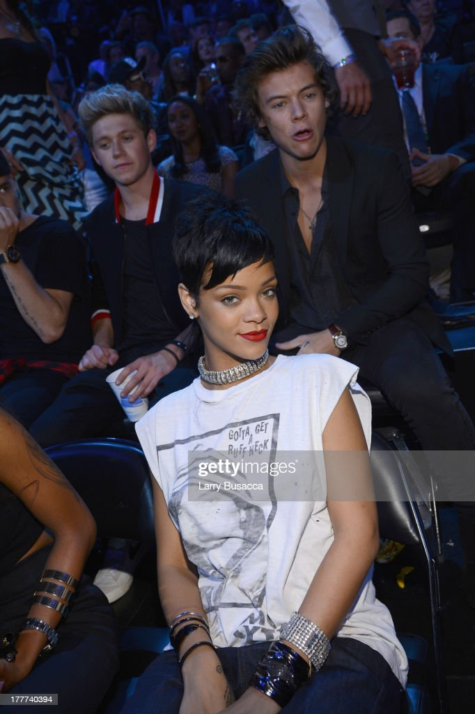 <a gi-track='captionPersonalityLinkClicked' href=/galleries/search?phrase=Rihanna&family=editorial&specificpeople=453439 ng-click='$event.stopPropagation()'>Rihanna</a> (front row) attends the 2013 MTV Video Music Awards at the Barclays Center on August 25, 2013 in the Brooklyn borough of New York City.