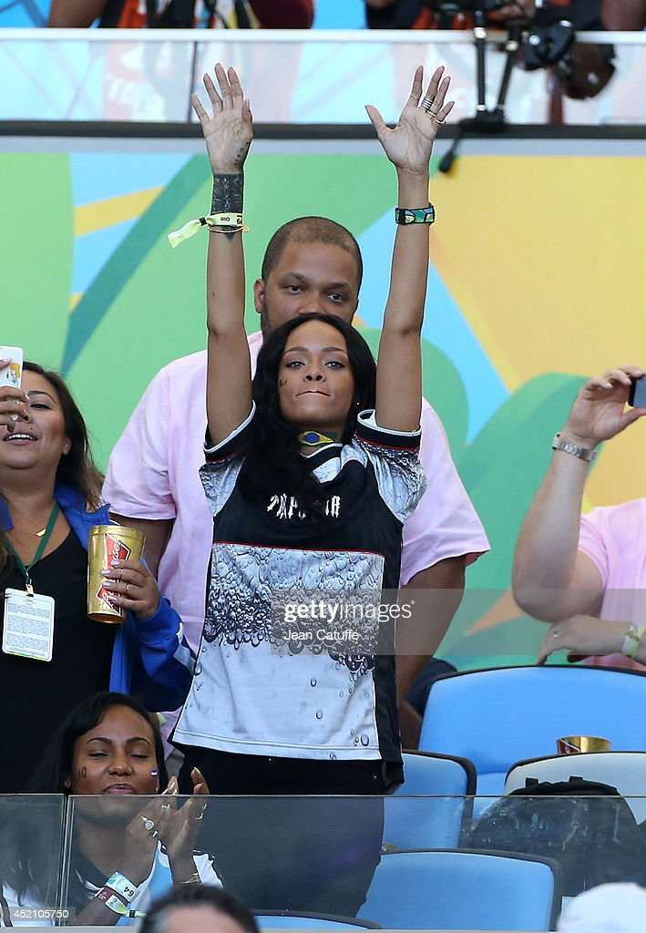 <a gi-track='captionPersonalityLinkClicked' href=/galleries/search?phrase=Rihanna&family=editorial&specificpeople=453439 ng-click='$event.stopPropagation()'>Rihanna</a> attends the 2014 FIFA World Cup Brazil Final match between Germany and Argentina at Estadio Maracana on July 13, 2014 in Rio de Janeiro, Brazil.