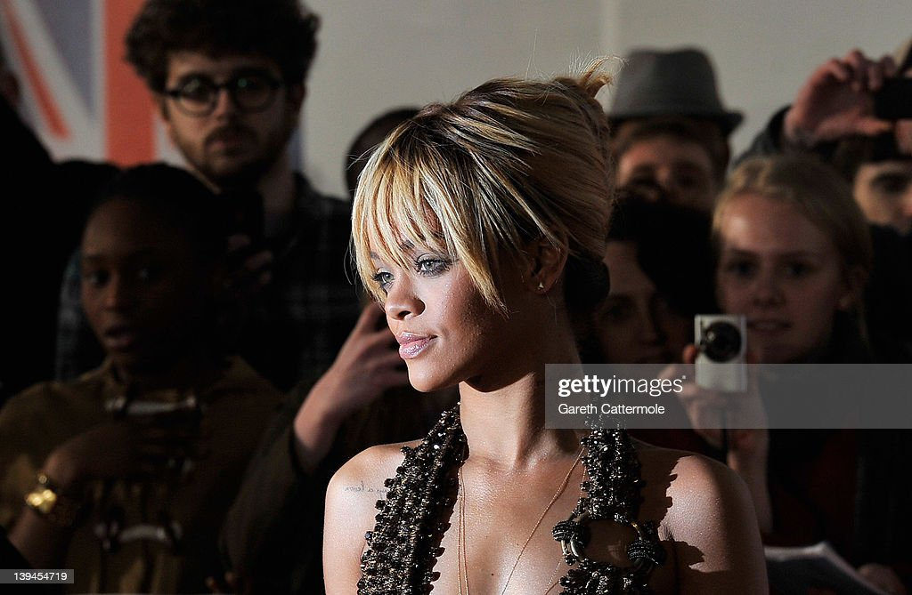 <a gi-track='captionPersonalityLinkClicked' href=/galleries/search?phrase=Rihanna&family=editorial&specificpeople=453439 ng-click='$event.stopPropagation()'>Rihanna</a> attends The BRIT Awards 2012 at the O2 Arena on February 21, 2012 in London, England.