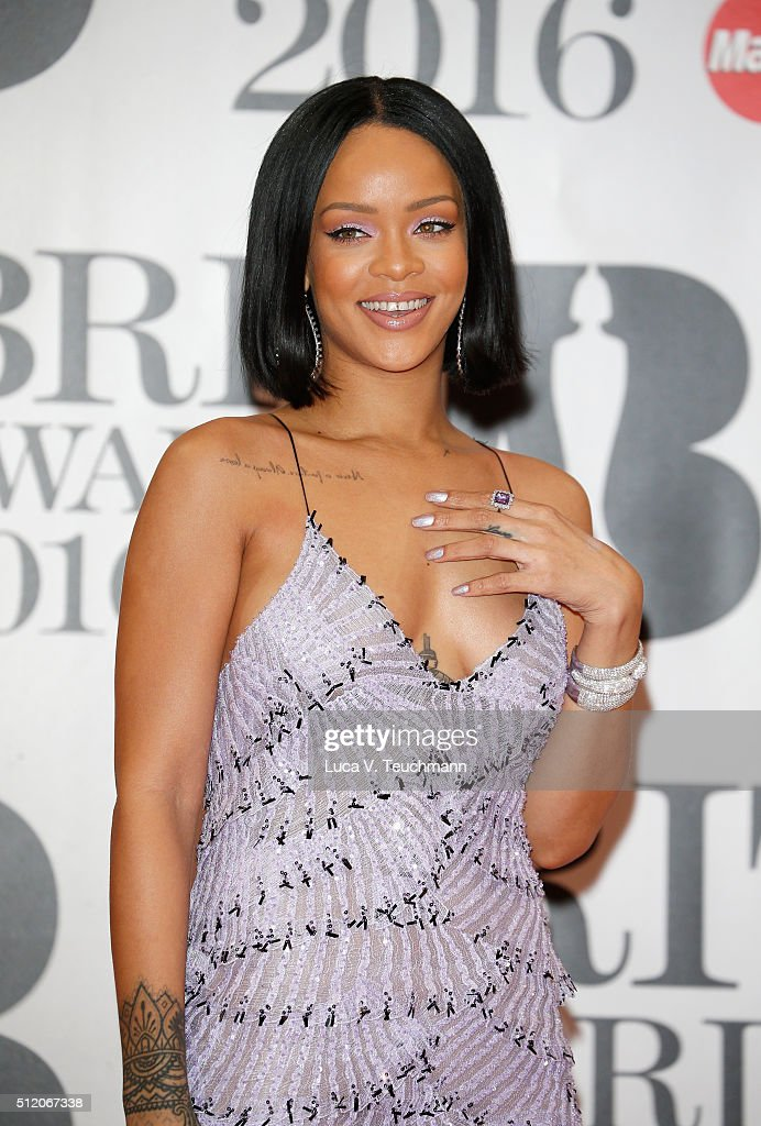 <a gi-track='captionPersonalityLinkClicked' href=/galleries/search?phrase=Rihanna&family=editorial&specificpeople=453439 ng-click='$event.stopPropagation()'>Rihanna</a> attends the BRIT Awards 2016 at The O2 Arena on February 24, 2016 in London, England.
