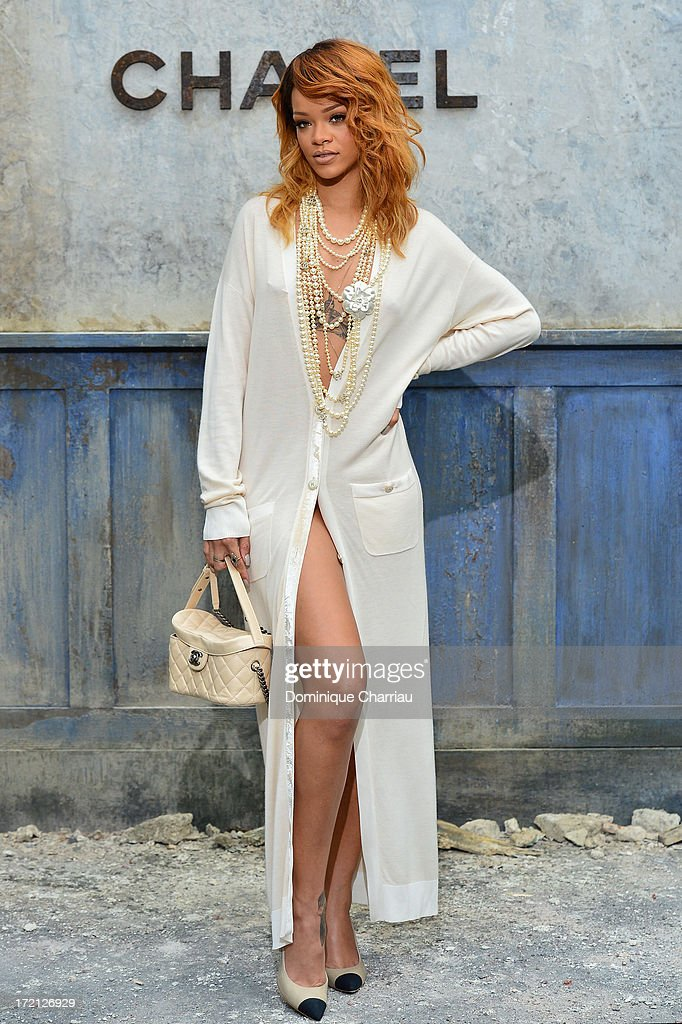 <a gi-track='captionPersonalityLinkClicked' href=/galleries/search?phrase=Rihanna&family=editorial&specificpeople=453439 ng-click='$event.stopPropagation()'>Rihanna</a> attends the Chanel show as part of Paris Fashion Week Haute Couture Fall/Winter 2013-2014 at Grand Palais on July 2, 2013 in Paris, France.