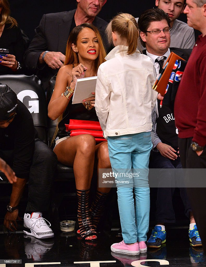 <a gi-track='captionPersonalityLinkClicked' href=/galleries/search?phrase=Rihanna&family=editorial&specificpeople=453439 ng-click='$event.stopPropagation()'>Rihanna</a> attends the Chicago Bulls Vs Brooklyn Nets Playoff Game at the Barclays Center on May 4, 2013 in the Brooklyn borough of New York City.