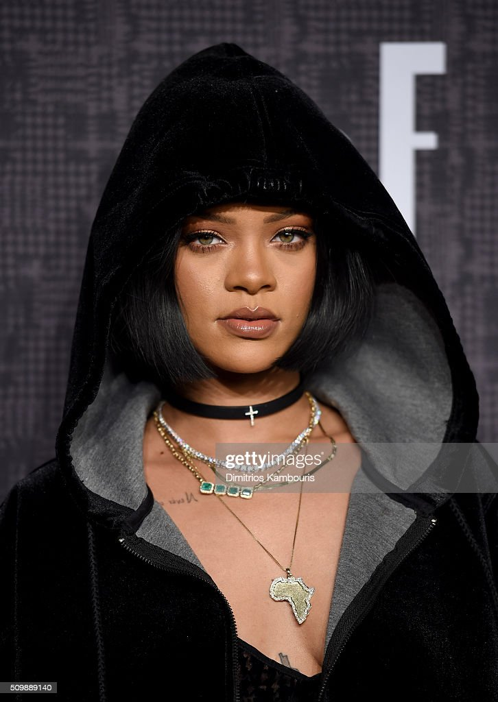 <a gi-track='captionPersonalityLinkClicked' href=/galleries/search?phrase=Rihanna&family=editorial&specificpeople=453439 ng-click='$event.stopPropagation()'>Rihanna</a> attends the FENTY PUMA by <a gi-track='captionPersonalityLinkClicked' href=/galleries/search?phrase=Rihanna&family=editorial&specificpeople=453439 ng-click='$event.stopPropagation()'>Rihanna</a> AW16 Collection during Fall 2016 New York Fashion Week at 23 Wall Street on February 12, 2016 in New York City.