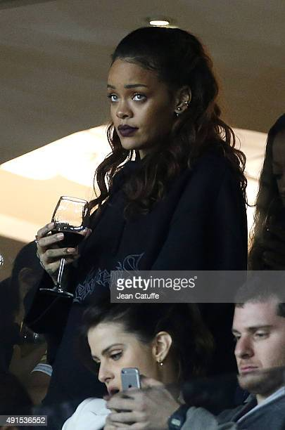 Rihanna attends the French Ligue 1 match between Paris SaintGermain FC and Olympique de Marseille at Parc des Princes stadium on October 4 2015 in...