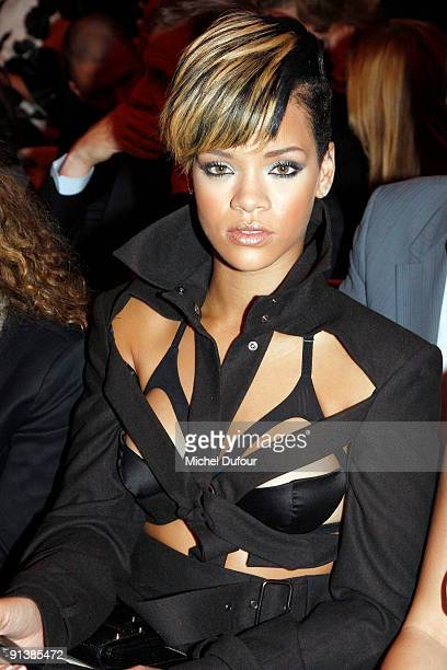 Rihanna attends the JeanPaul Gaultier Pret a Porter show during Paris Womenswear Fashion Week Spring/Summer 2010 at 325 Rue Saint Martin on October 3...