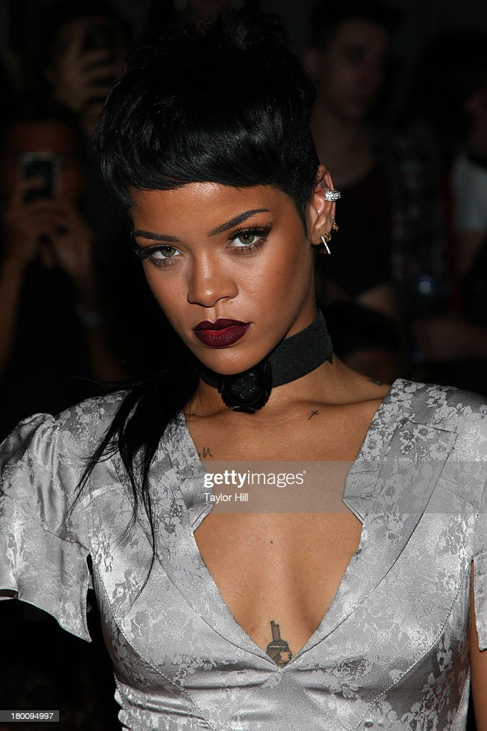 <a gi-track='captionPersonalityLinkClicked' href=/galleries/search?phrase=Rihanna&family=editorial&specificpeople=453439 ng-click='$event.stopPropagation()'>Rihanna</a> attends the Opening Ceremony Spring 2014 fashion show at on September 8, 2013 in New York City.