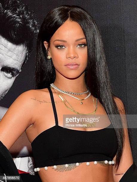 Rihanna attends the Rogue Man By Rihanna Fragrance Launch at Macy's Lenox Square on October 25 2014 in Atlanta Georgia