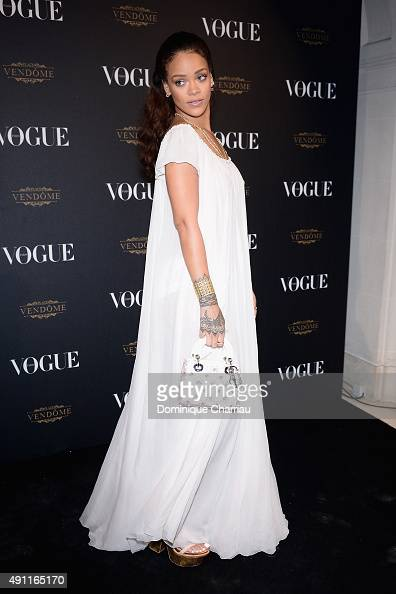 Rihanna attends the Vogue 95th Anniversary Party Photocall as part of the Paris Fashion Week Womenswear Spring/Summer 2016 on October 3 2015 in Paris...