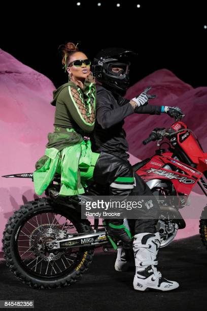 Rihanna blows a kiss to the audience on the back of a motorcycle after the conclusion of her Fenty Puma By Rihanna Runway show in September 2017 New...
