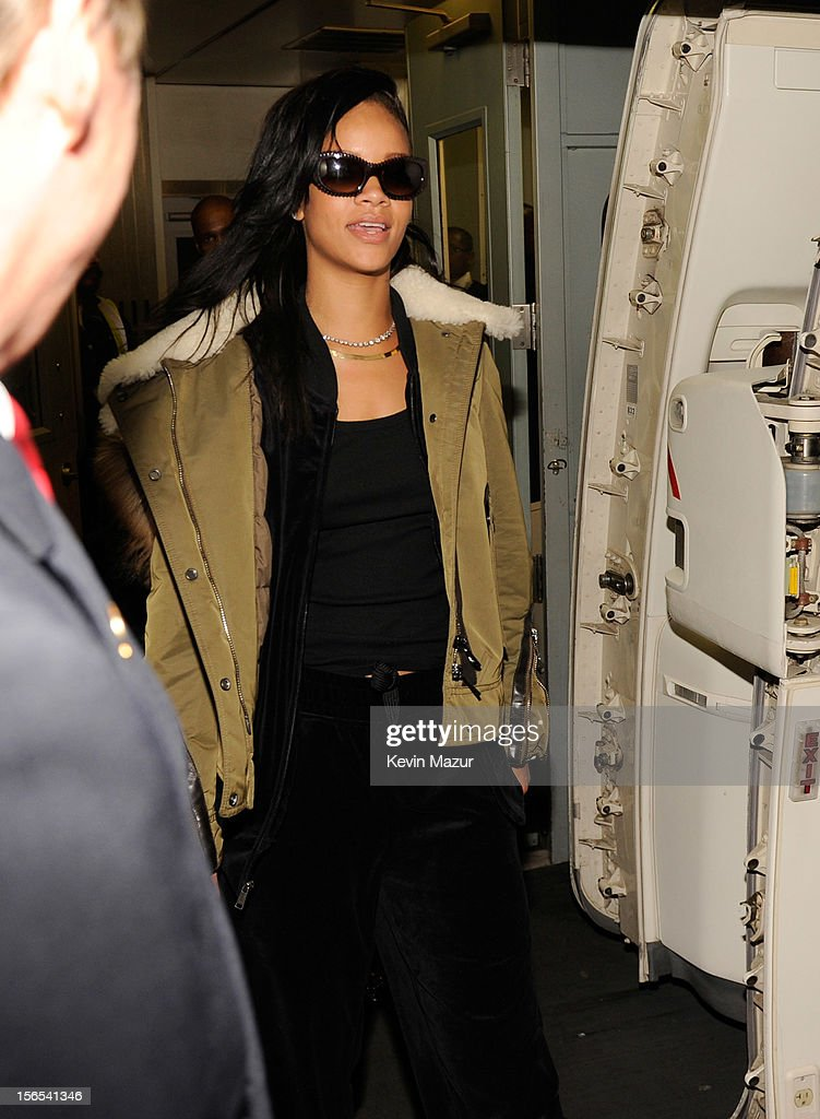 <a gi-track='captionPersonalityLinkClicked' href=/galleries/search?phrase=Rihanna&family=editorial&specificpeople=453439 ng-click='$event.stopPropagation()'>Rihanna</a> boards her plane following her show at The Danforth on November 15, 2012 in Toronto, Ontario. <a gi-track='captionPersonalityLinkClicked' href=/galleries/search?phrase=Rihanna&family=editorial&specificpeople=453439 ng-click='$event.stopPropagation()'>Rihanna</a>'s 777 Tour - 7 countries, 7 days, 7 shows in celebration of the November 19, 2012 release of 'Unapologetic.'