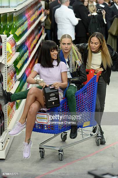 Rihanna Cara Delevigne and Joan Smalls attend the Chanel show as part of the Paris Fashion Week Womenswear Fall/Winter 20142015 on March 4 2014 in...