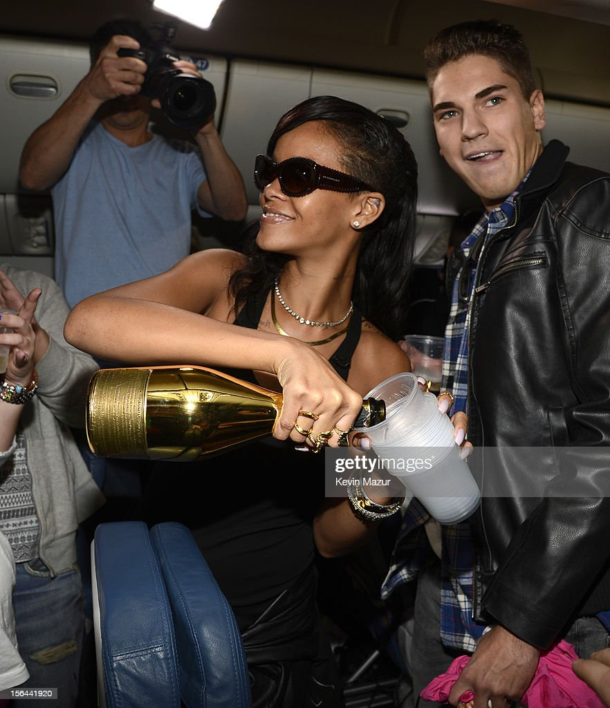 Rihanna celebrates with fans on the plane to her first stop on the 777 tour on November 14, 2012. Rihanna's 777 Tour - 7 countries, 7 days, 7 shows in celebration of the November 19, 2012 release of 'Unapologetic.'
