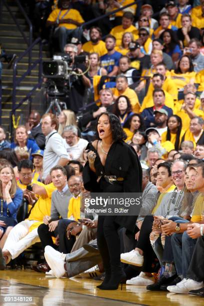 Rihanna cheers from the side line during the game of the Golden State Warriors and the Cleveland Cavaliers in Game One of the 2017 NBA Finals on June...