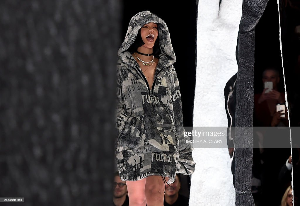 Rihanna displays fashions during the Fenty PUMA by Rihanna show during the Fall 2016 New York Fashion Week in New York on February 12, 2016. / AFP / Timothy A. CLARY