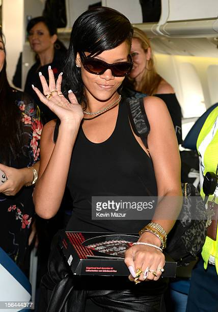 Rihanna greets guests on the plane to her first stop on the 777 tour on November 14 2012 Rihanna's 777 Tour 7 countries 7 days 7 shows in celebration...