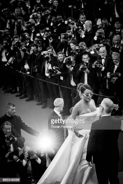 Rihanna is greeted by Director of the Cannes Film Festival Thierry Fremaux as they attend the 'Okja' screening during the 70th annual Cannes Film...