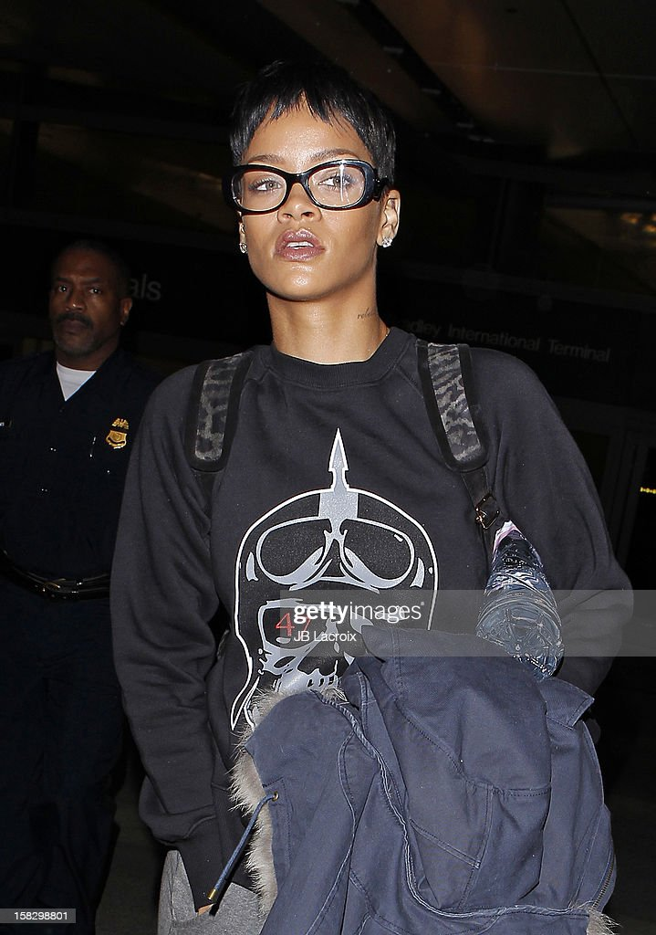 <a gi-track='captionPersonalityLinkClicked' href=/galleries/search?phrase=Rihanna&family=editorial&specificpeople=453439 ng-click='$event.stopPropagation()'>Rihanna</a> is seen at LAX Airport on December 12, 2012 in Los Angeles, California.