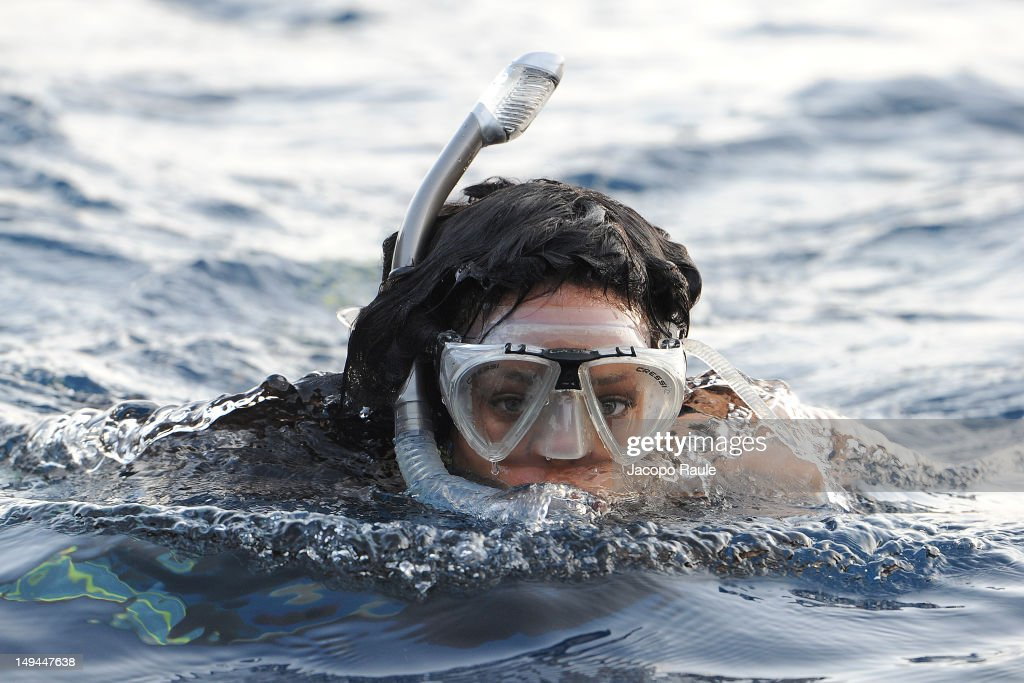 <a gi-track='captionPersonalityLinkClicked' href=/galleries/search?phrase=Rihanna&family=editorial&specificpeople=453439 ng-click='$event.stopPropagation()'>Rihanna</a> is seen snorkeling on July 28, 2012 in Portofino, Italy.