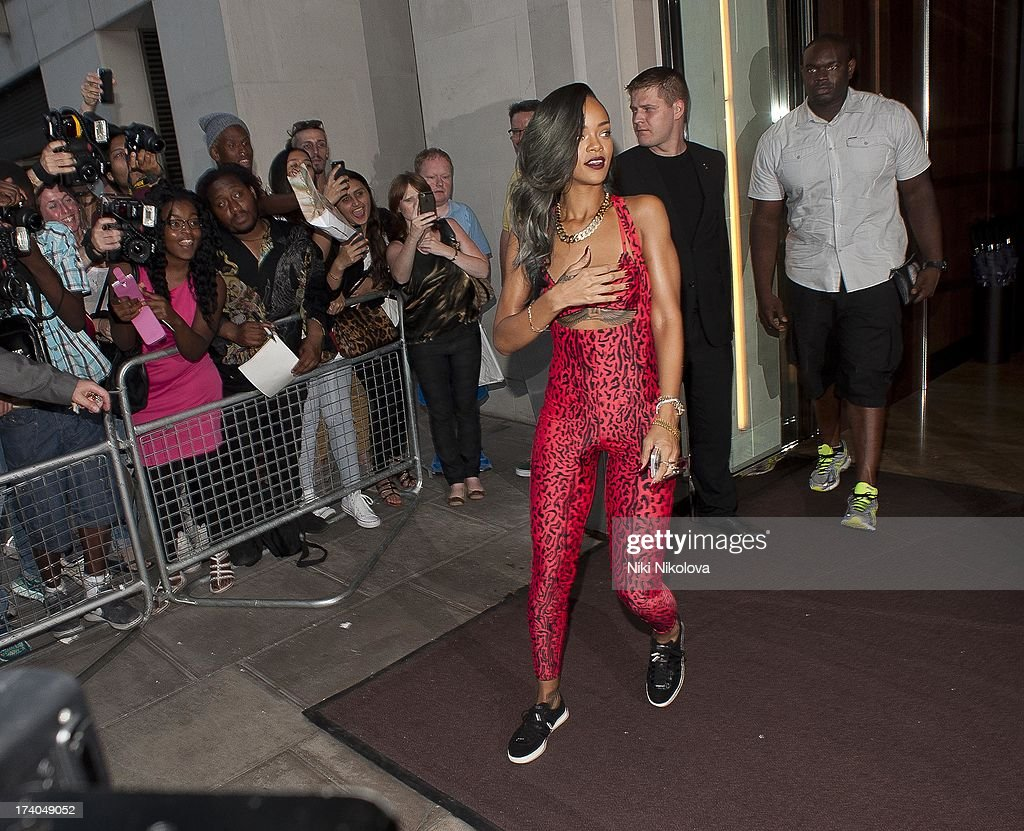<a gi-track='captionPersonalityLinkClicked' href=/galleries/search?phrase=Rihanna&family=editorial&specificpeople=453439 ng-click='$event.stopPropagation()'>Rihanna</a> Leaving 45 Park Lane on July 19, 2013 in London, England.