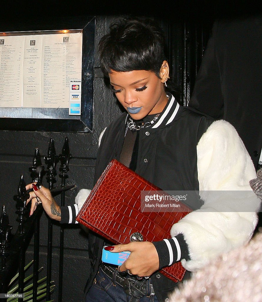 <a gi-track='captionPersonalityLinkClicked' href=/galleries/search?phrase=Rihanna&family=editorial&specificpeople=453439 ng-click='$event.stopPropagation()'>Rihanna</a> leaving Nozomi restaurant on September 10, 2013 in London, England.