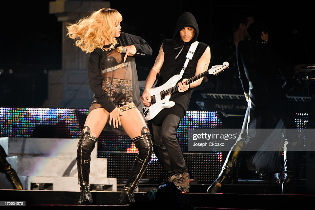 <a gi-track='captionPersonalityLinkClicked' href=/galleries/search?phrase=Rihanna&family=editorial&specificpeople=453439 ng-click='$event.stopPropagation()'>Rihanna</a> performs at Twickenham Stadium on June 15, 2013 in London, England.