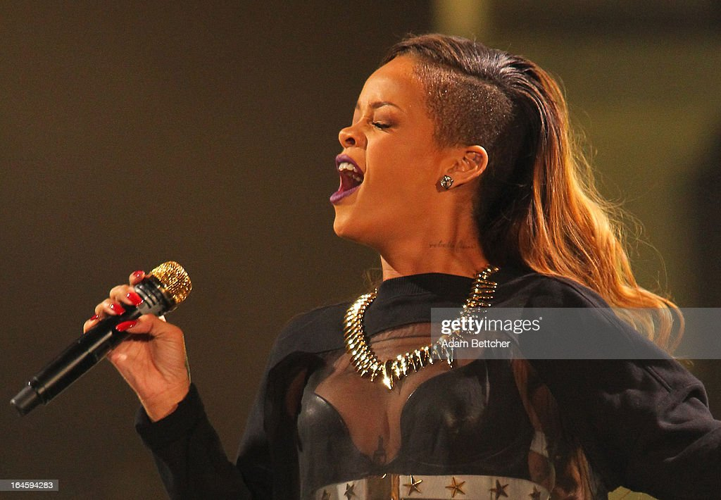 <a gi-track='captionPersonalityLinkClicked' href=/galleries/search?phrase=Rihanna&family=editorial&specificpeople=453439 ng-click='$event.stopPropagation()'>Rihanna</a> performs during her 'Diamonds' world tour at Xcel Energy Center on March 24, 2013 in St. Paul, Minnesota.